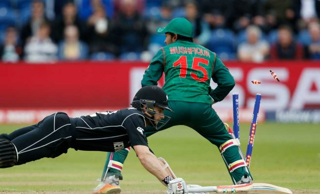 New Zealand\'s Kane Williamson dives as Bangladesh\'s Mushfiqur Rahim attempts to run him out ...