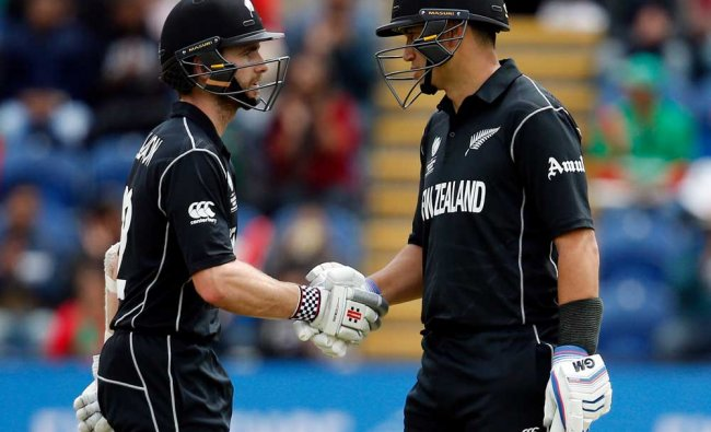 New Zealand\'s Kane Williamson celebrates his half century with Ross Taylor