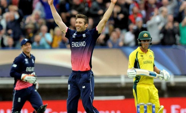 England\'s Mark Wood celebrates after bowling Australia\'s Glenn Maxwell caught by England\'s Jason...