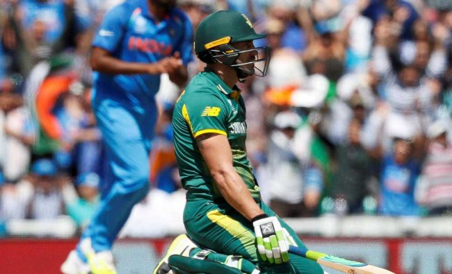 South Africa\'s Faf du Plessis falls to his knees as South Africa\'s David Miller is run out...