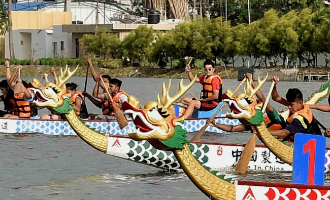 Chinese peoples participate during the Dragon Boat festival in Kolkata on Sunday.