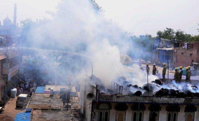 Firemen try to control fire that broke at Pigeon Market (Kabutar market) near Jama masjid...