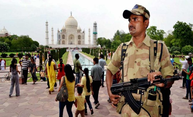 A security personnel standing guard in front of the world famous Taj Mahal following a terror...