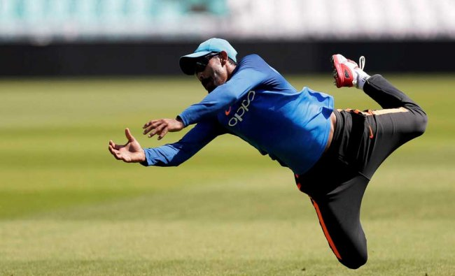 India\'s Ravindra Jadeja makes a catch...
