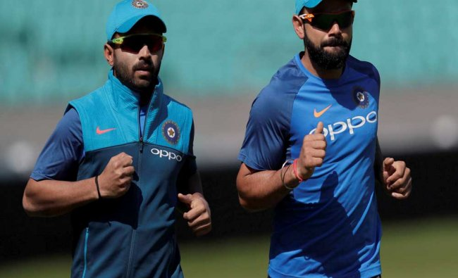 India\'s captain Virat Kohl, right, runs with India\'s Ajinkya Rahane...