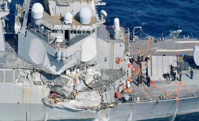 The damage of the right side of the USS Fitzgerald is seen off Shimoda...