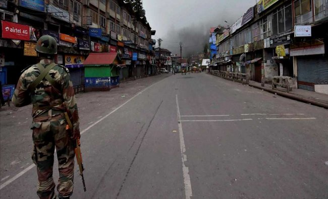 Security personnel patrol a road during GJM strike...