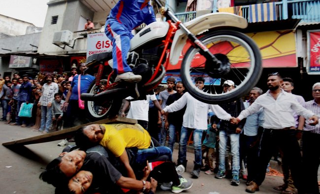 Devotees perform a stunt during a rehearsal for the annual Rath Yatra of Lord Jagannath...