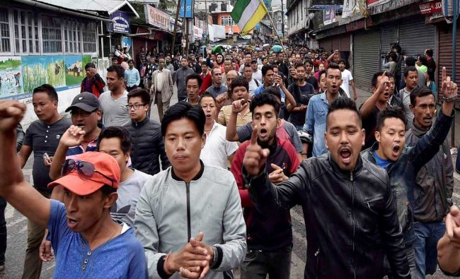 Gorkha Janamukti Morcha supporters shout slogans at a protest rally during their indefinite strike..