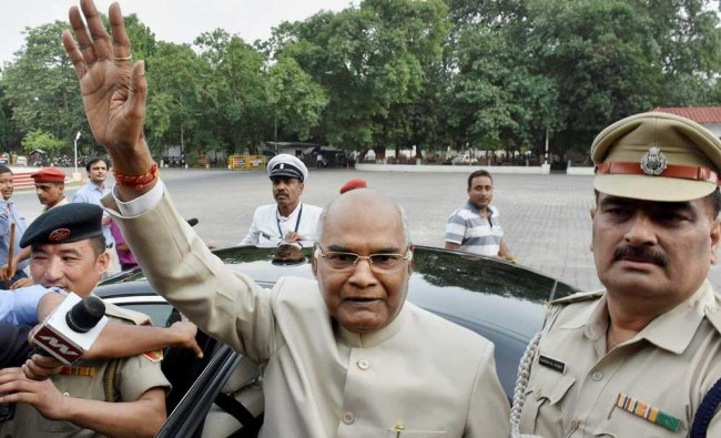Bihar Governor Ram Nath Kovind, NDA\'s presidential candidate, waves at the media as he leaves for...
