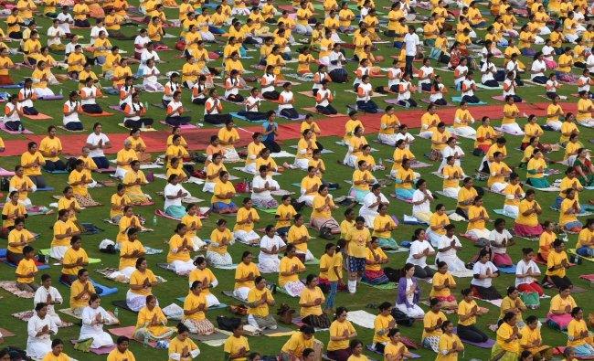 Students and various Yoga centre members participated in International Yoga Day programme...