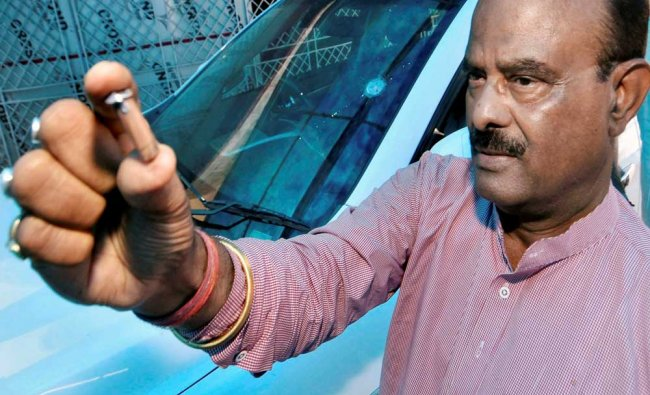 Former Union minister Nagmani showing a bullet which was fired from an unidentified assailant...