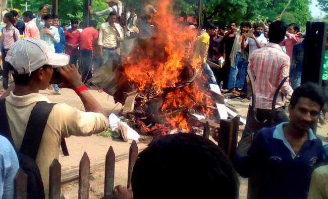 Angry students burn railway properties during a violent protest against Central government over...
