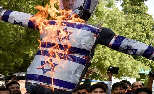 Members of Majlis-e-Ulama-e-Hind (Delhi state) burn an effigy during a protest against Israel at...
