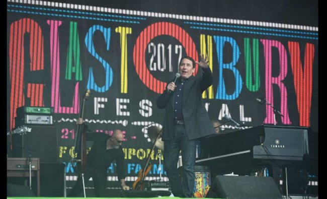 Jools Holland performs on the Pyramid Stage at Worthy Farm in Somerset during the Glastonbury...