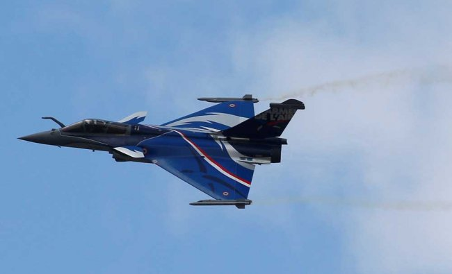 A Dassault Rafale fighter takes part to a flying display during the 52nd Paris Air Show at...
