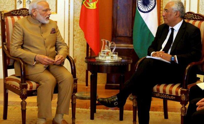 India\'s Prime Minister Narendra Modi, left and Portuguese Prime Minister Antonio Costa speak...