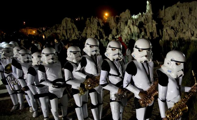 A student band dressed as Star Wars storm troopers hold their instruments during the walk...