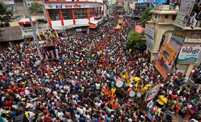 Hindu devotees pull the \'Rath\' or the chariot of Lord Jagannath, during the annual Rath Yatra, or...