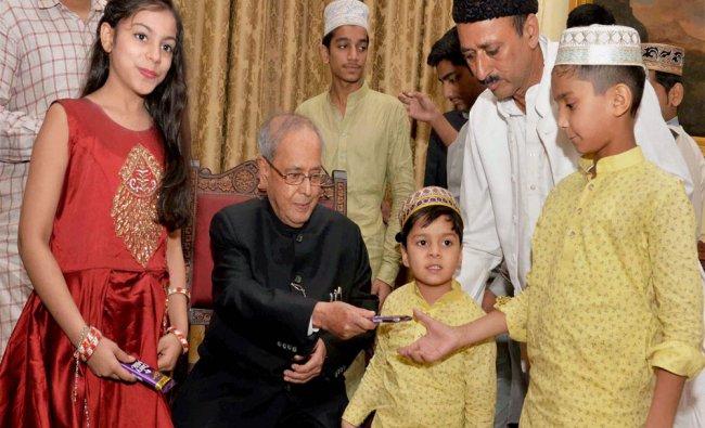 President Pranab Mukherjee receiving Eid greetings from various groups of people...