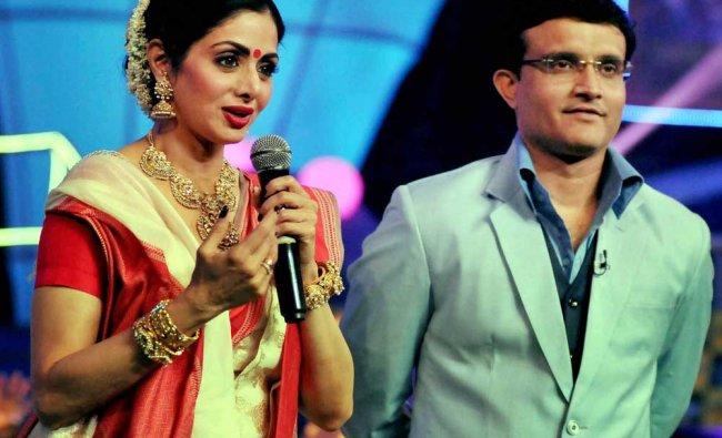 Bollywood actress Sridevi, in a traditional Bengali attire, speaks as former Indian cricket...