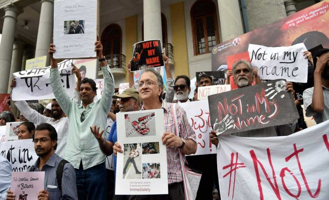 Noted historian and writer Ramchandra Guha along with other citizens holding placards during...