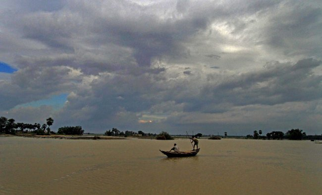 Monsoon clouds gather over the Kunye River in Birbhum district of West Bengal on Thursday.