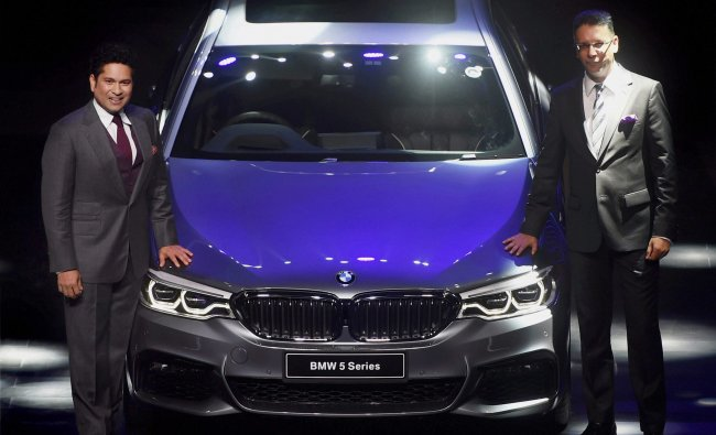 Cricket legend Sachin Tendulkar and President of BMW India Vikram Pawah at the launch of the BMW 5..