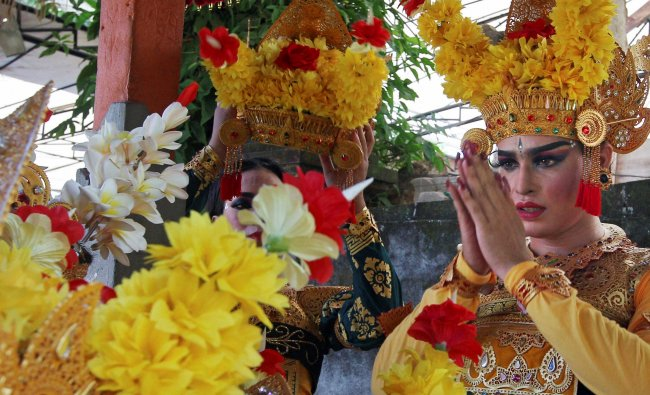 A male traditional dancer prays for a successful performance during the Bali Arts Festival in Bali..