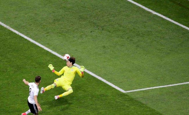 Mexico goalkeeper Guillermo Ochoa fails to save the ball as Germany\'s Leon Goretzka, left scores...