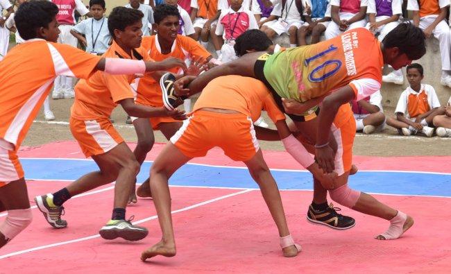 Team Yadgir and Team Raichur in action during Kalaburgi Zonal Pro Kabbadi tournament at SRN Mehta...