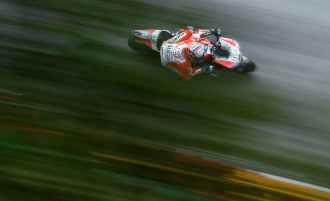Italian MotoGP rider Andrea Dovizioso of Ducati in action during the 3rd free training at the...