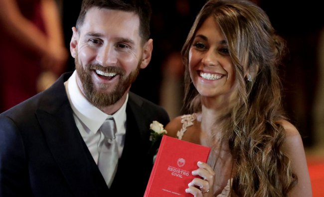 Newlyweds Lionel Messi and Antonella Roccuzzo pose for photographers after tying the knot...