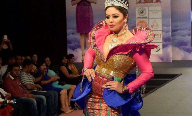 A model walks the ramp at a fashion show in Guwahati on Friday night.