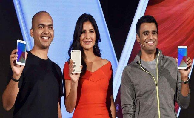 Xiaomi\'s India head Manu Jain with actress Katrina Kaif and Lead Product Manager, Xiaomi...