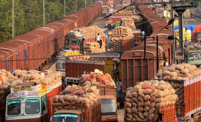 Labourers loading onion sacks on the trucks from a Goods train in Kolkata...