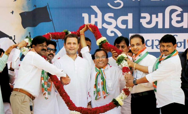 Congress vice-president Rahul Gandhi being garlanded by the supporters during a public meeting...