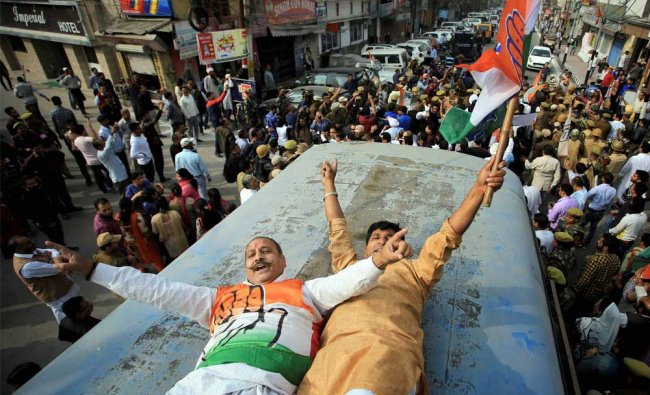Jammu and Kashmir police detain Congress activists during their protest against state government...