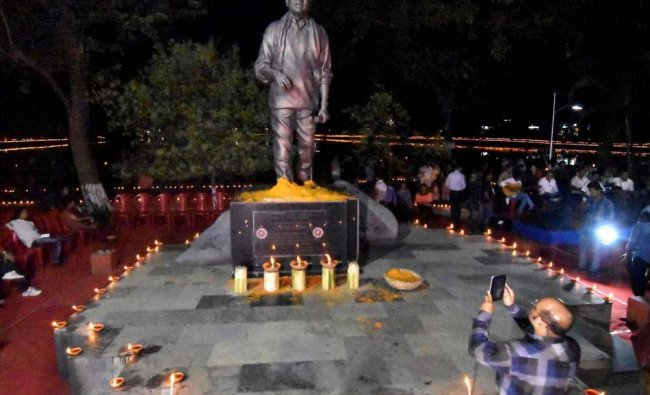 Members of All Assam Students Union (AASU) light 10 thousand earthen lamps (diyas) at...