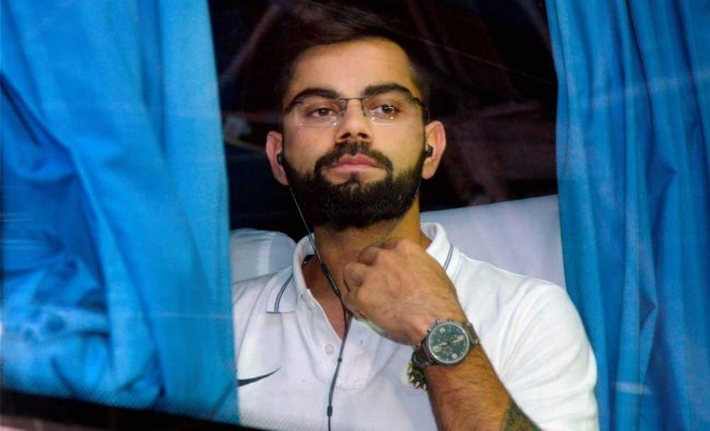 Skipper Virat Kohli on his arrival at the Thiruvananthapuram airport on Tuesday ahead...
