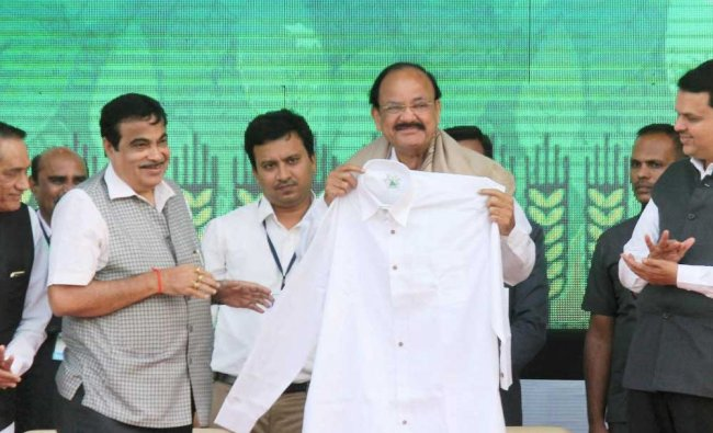 Vice President M Venkaiah Naidu showing a bamboo made shirt while Union Minister Nitin Gadkari..