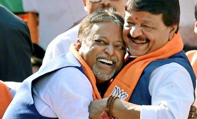 Mukul Roy, who recently joined BJP, seen hugging BJP leader Kailash Vijayvargiya during a rally ...