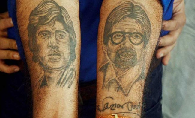 A fan displays the tattoo of megastar Amitabh Bachhan on his arm after the actor (unseen) arrived...