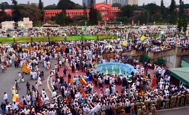 Supporters of Hazrat Tipu Sultan with flags infront of Vidhan Soudha during the celebration ...