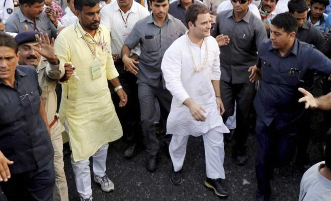 Congress vice president Rahul Gandhi during his road show at Vadali of Sabarkatha district on ...