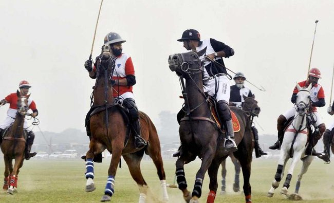 Polo players in action during the Westren Command Polo Challenge at The Patiala Polo and Riding ...