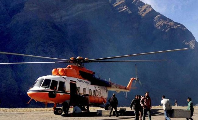 EVM being taken to Bhuntar by helicopter for counting after voting for Assembley elections in ...