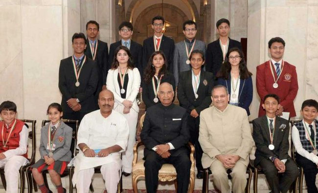 President Ram Nath Kovind in a group photograph with the awardees during the National Child Awards..