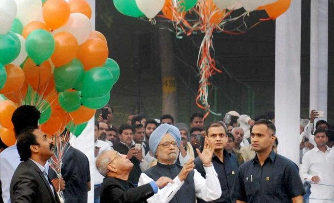 Former President Pranab Mukherjee and former prime minister Manmohan Singh releasing...