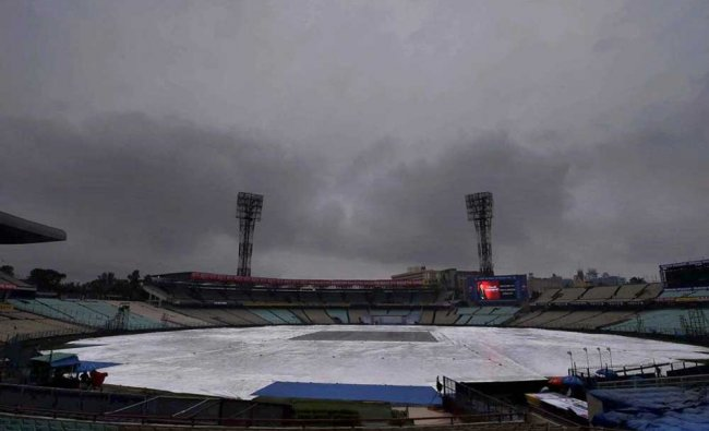 The ground at Eden Gardens is covered as the dark clouds hover in the sky, in Kolkata on Wednesday..